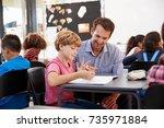 teacher and young school boy... | Shutterstock . vector #735971884