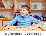 cheerful boy with disability at ... | Shutterstock . vector #735975889