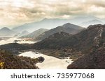 mountains haze landscape with... | Shutterstock . vector #735977068
