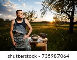 young man potter making ceramic ... | Shutterstock . vector #735987064