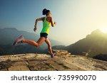 young woman trail runner... | Shutterstock . vector #735990070