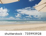 beach   sunshade on the beach... | Shutterstock . vector #735993928