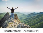 a man stands high in the... | Shutterstock . vector #736008844