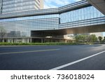 empty road with modern... | Shutterstock . vector #736018024
