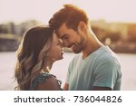 Stock photo young happy couple enjoys spending time outdoor together happy couple image is intentionally toned 736044826