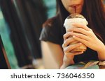 young asian woman drinking ice... | Shutterstock . vector #736046350