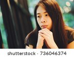 young asian woman thinking... | Shutterstock . vector #736046374
