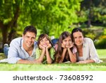 family lying down in the park | Shutterstock . vector #73608592