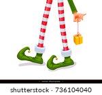 elf's legs and elf's hand with... | Shutterstock .eps vector #736104040