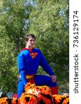 Small photo of NORMAN, OKLAHOMA - OCTOBER 13 2007: Unidentified man on Superman costume in homecoming event