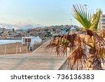 wooden boardwalk along the... | Shutterstock . vector #736136383