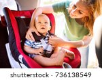 young mother putting baby boy... | Shutterstock . vector #736138549