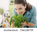 smiling woman smelling fresh... | Shutterstock . vector #736138759