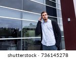 young casual man using... | Shutterstock . vector #736145278