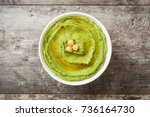 avocado hummus in bowl on... | Shutterstock . vector #736164730