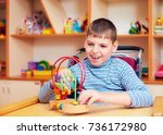 cheerful boy with disability at ... | Shutterstock . vector #736172980