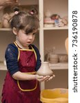 pottery workshop   girl sculpts ... | Shutterstock . vector #736190878