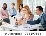 attentive blonde working with... | Shutterstock . vector #736197586
