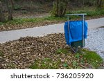 blue garbage bag in green iron... | Shutterstock . vector #736205920