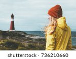 woman sightseeing lighthouse... | Shutterstock . vector #736210660