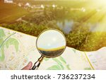 magnifying glass against map | Shutterstock . vector #736237234