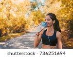 woman athlete takes a break ... | Shutterstock . vector #736251694