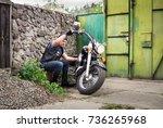 the biker inspects his... | Shutterstock . vector #736265968