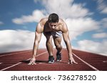 sport. young runner on the... | Shutterstock . vector #736278520