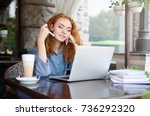 thoughtful redhead freelancer... | Shutterstock . vector #736292320
