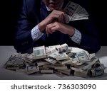 rich business man holding... | Shutterstock . vector #736303090