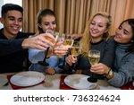 friends clinking wine glasses... | Shutterstock . vector #736324624
