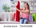 young woman with shopping bags... | Shutterstock . vector #736332088