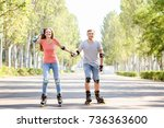 young couple rollerskating in... | Shutterstock . vector #736363600