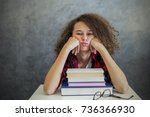 portrait of tired curly hair... | Shutterstock . vector #736366930