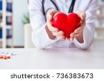 doctor cardiologist with red... | Shutterstock . vector #736383673