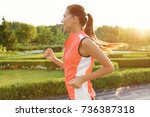 sporty young woman running in... | Shutterstock . vector #736387318