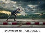 businessman with white umbrella ... | Shutterstock . vector #736390378