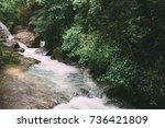 mountain river flowing through... | Shutterstock . vector #736421809