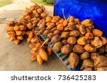 raw coconut in a local market... | Shutterstock . vector #736425283