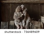a scene of poverty with two... | Shutterstock . vector #736489609