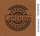 capitalism wooden emblem.... | Shutterstock .eps vector #736489939