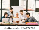 multiethnic team busy... | Shutterstock . vector #736497283