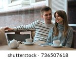 young nice couple sitting in... | Shutterstock . vector #736507618