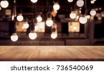 wood table top on blurred of... | Shutterstock . vector #736540069