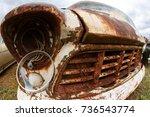 a broken headlight hangs from...   Shutterstock . vector #736543774