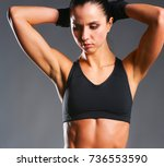 muscular young woman posing in... | Shutterstock . vector #736553590