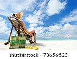 Woman On A Tropical Beach With...