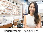 business owner in optical shop | Shutterstock . vector #736571824
