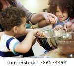 family baking together in the... | Shutterstock . vector #736574494