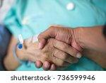 shake hands cancer patients | Shutterstock . vector #736599946